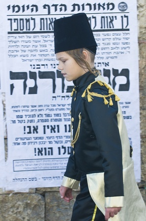 JERUSALEM - MARS 09 : Ultra Orthodox costumed boy during Purim in Mea Shearim Jerusalem on Mars 09 2012 , Purim is a Jewish holiday celebrates the salvation of the jews from jenocide in ancient Persia  Stock Photo - 12618653