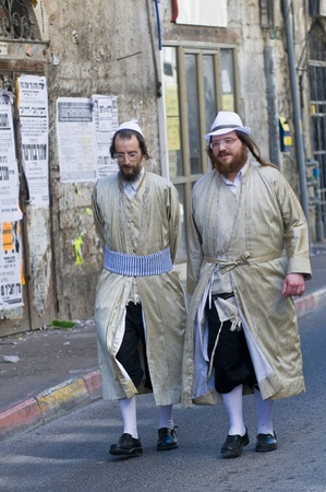 hasidim: JERUSALEM - MARS 09 : Ultra Orthodox men during Purim in Mea Shearim Jerusalem on Mars 09 2012 , Purim is a Jewish holiday celebrates the salvation of the jews from jenocide in ancient Persia