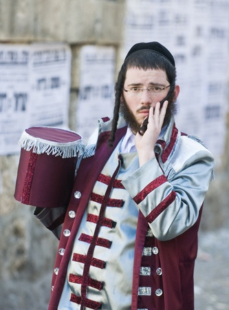mea: JERUSALEM - MARS 09 : Ultra Orthodox man during Purim in Mea Shearim Jerusalem on Mars 09 2012 , Purim is a Jewish holiday celebrates the salvation of the jews from jenocide in ancient Persia