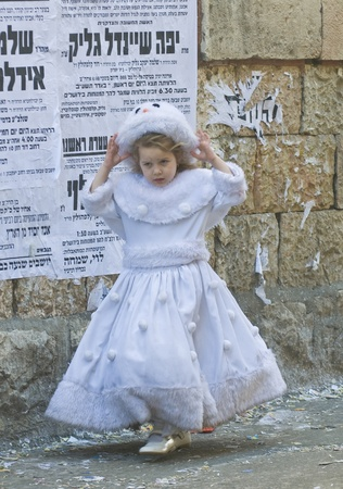 haredi: JERUSALEM - MARS 09 : Ultra Orthodox costumed girl during Purim in Mea Shearim Jerusalem on Mars 09 2012 , Purim is a Jewish holiday celebrates the salvation of the jews from jenocide in ancient Persia