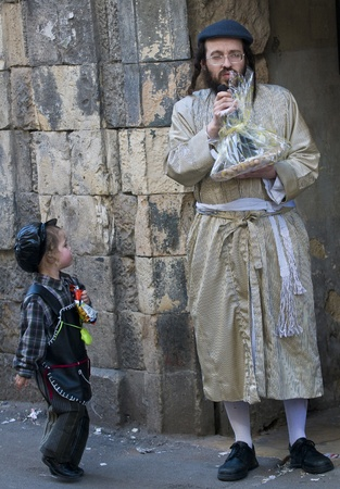 JERUSALEM - MARS 09 : Ultra Orthodox man holding Mishloach Manot during Purim in Mea Shearim Jerusalem on Mars 09 2012 , Mishloach Manot is traditional food gifts given during Purim Stock Photo - 12618683