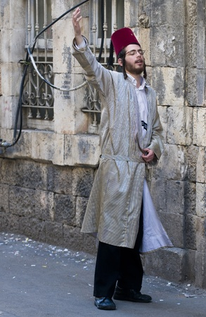 hasidic: JERUSALEM - MARS 09 : Ultra Orthodox man during Purim in Mea Shearim Jerusalem on Mars 09 2012 , Purim is a Jewish holiday celebrates the salvation of the jews from jenocide in ancient Persia