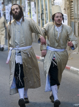 haredi: JERUSALEM - MARS 09 : Ultra Orthodox men during Purim in Mea Shearim Jerusalem on Mars 09 2012 , Purim is a Jewish holiday celebrates the salvation of the jews from jenocide in ancient Persia