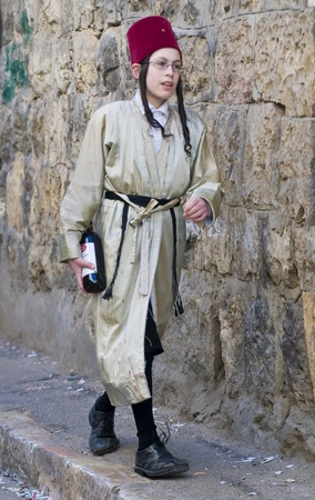 JERUSALEM - MARS 09 : Ultra Orthodox costumed boy during Purim in Mea Shearim Jerusalem on Mars 09 2012 , Purim is a Jewish holiday celebrates the salvation of the jews from jenocide in ancient Persia  Stock Photo - 12618662