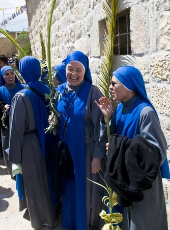 JERUSALEM - APRIL 01 : Unidentified nuns take part in the Palm sunday procession in Jerusalem on April 01 2012 , Palm sunday marks the beginning of the Holy week and Jesus christs entrance into Jerusalem.