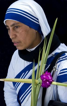 JERUSALEM - APRIL 01 : Unidentified nun take part in the Palm sunday procession in Jerusalem on April 01 2012 , Palm sunday marks the beginning of the Holy week and Jesus christ's entrance into Jerusalem.   Stock Photo - 13021932