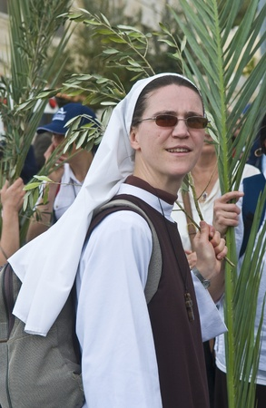 JERUSALEM - APRIL 01 : Unidentified nun take part in the Palm sunday procession in Jerusalem on April 01 2012 , Palm sunday marks the beginning of the Holy week and Jesus christs entrance into Jerusalem.