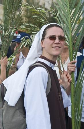JERUSALEM - APRIL 01 : Unidentified nun take part in the Palm sunday procession in Jerusalem on April 01 2012 , Palm sunday marks the beginning of the Holy week and Jesus christs entrance into Jerusalem.