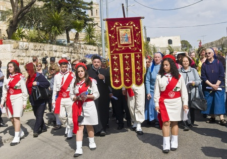 JERUSALEM - APRIL 01 : Christian Palestinians take part in the Palm sunday procession in Jerusalem on April 01 2012 , Palm sunday marks the beginning of the Holy week and Jesus christ's entrance into Jerusalem.   Stock Photo - 13021427