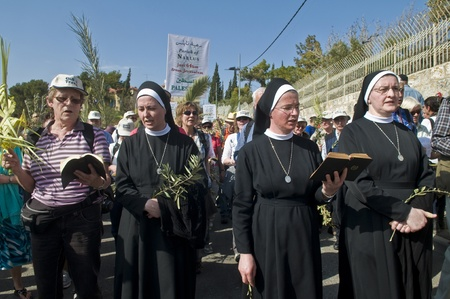 JERUSALEM - APRIL 01 : Unidentified nuns take part in the Palm sunday procession in Jerusalem on April 01 2012 , Palm sunday marks the beginning of the Holy week and Jesus christ's entrance into Jerusalem.   Stock Photo - 13021423