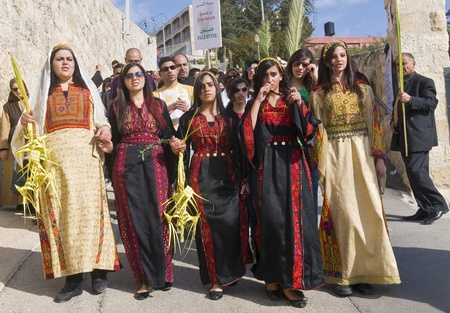 JERUSALEM - APRIL 01 : Christian Palestinians take part in the Palm sunday procession in Jerusalem on April 01 2012 , Palm sunday marks the beginning of the Holy week and Jesus christs entrance into Jerusalem.