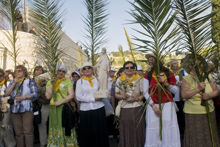 JERUSALEM - APRIL 01 : Christian Pilgrims take part in the Palm sunday procession in Jerusalem on April 01 2012 , Palm sunday marks the beginning of the Holy week and Jesus christ's entrance into Jerusalem.   Stock Photo - 13021409
