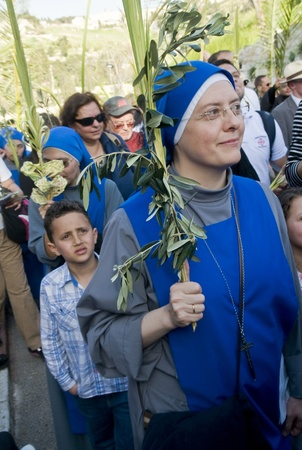 JERUSALEM - APRIL 01 : Christian Pilgrims take part in the Palm sunday procession in Jerusalem on April 01 2012 , Palm sunday marks the beginning of the Holy week and Jesus christ's entrance into Jerusalem.   Stock Photo - 13021943