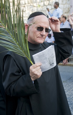 JERUSALEM - APRIL 01 : Unidentified bishop take part in the Palm sunday procession in Jerusalem on April 01 2012 , Palm sunday marks the beginning of the Holy week and Jesus christs entrance into Jerusalem.