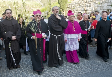 JERUSALEM - APRIL 01 : The Latin Patriarch of Jerusalem Fouad Twal take part in the Palm sunday procession in Jerusalem on April 01 2012 , Palm sunday marks the beginning of the Holy week and Jesus christs entrance into Jerusalem.