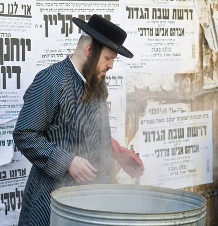 JERUSALEM - APRIL 05 : An Ultra Orthodox man is preparing to the Jewish holiday of Passover by purifacation of the dishes in Jerusalem Israel on April 05 2012 Stock Photo - 13073337