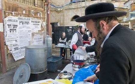 JERUSALEM - APRIL 05 : An Ultra Orthodox Jews are preparing to the Jewish holiday of Passover by purifacation of the dishes in Jerusalem Israel on April 05 2012