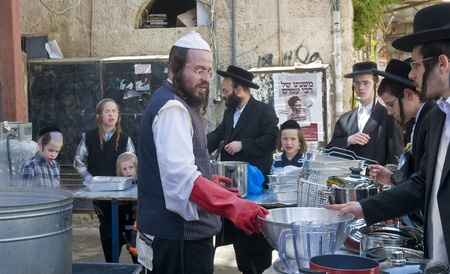 haredi: JERUSALEM - APRIL 05 : An Ultra Orthodox Jews are preparing to the Jewish holiday of Passover by purifacation of the dishes in Jerusalem Israel on April 05 2012