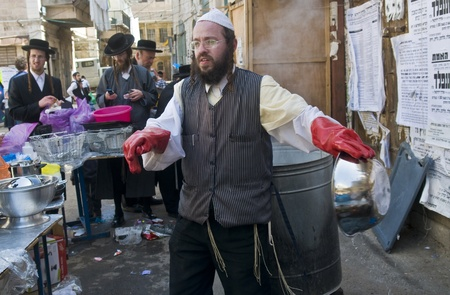 hasidim: JERUSALEM - APRIL 05 : An Ultra Orthodox Jews are preparing to the Jewish holiday of Passover by purifacation of the dishes in Jerusalem Israel on April 05 2012
