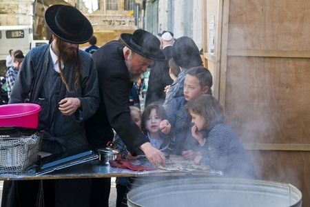 hasidic: JERUSALEM - APRIL 05 : An Ultra Orthodox Jews are preparing to the Jewish holiday of Passover by purifacation of the dishes in Jerusalem Israel on April 05 2012