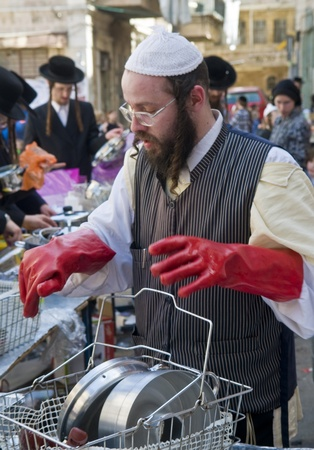 haredi: JERUSALEM - APRIL 05 : An Ultra Orthodox man is preparing to the Jewish holiday of Passover by purifacation of the dishes in Jerusalem Israel on April 05 2012 Editorial