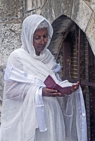 spirtual: JERUSALEM - APRIL 14 : Ethiopian Orthodox worshiper await the start of the Holy fire ceremony at the Ethiopian section of the Holy Sepulcher in Jerusalm Israel on April 14 2012