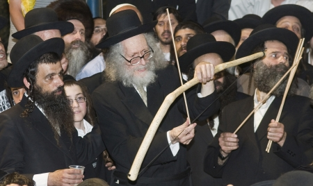 MERON , ISRAEL - MAY 10 : Rabbi Eliezer Berland shoot arrows with a bow in Bar Yochai tomb in Meron , Israel during Lag Baomer on May 10 2012 , Archery is one of Lag Baomer customs