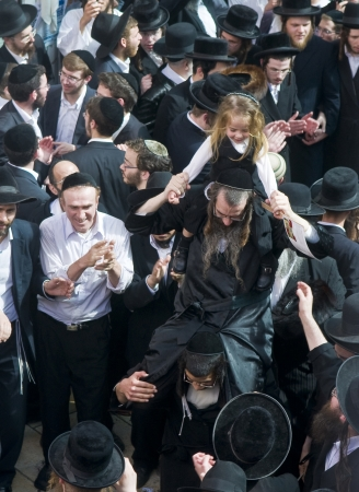 MERON , ISRAEL - MAY 10 : Orthodox Jews celebrates Halake in Bar Yochai tomb in Meron , Israel on May 10 2012 , Halake is first haircut ceremony celebrated in Lag Baomer