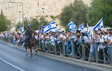 JERUSALEM - MAY 20 2012 : Israeli right wingers commemorating Jerusalem day with a march to Jerusalem old city on May 20 2012 , Jerusalem day marks the anniversary of Israel capturing the eastern part of the city during the 1967 Middle east war