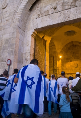 JERUSALEM - MAY 20 2012 : Right wing Israeli men in front of Damascus gate on Jerusalem day before marching throuh the Arab quarter of Jerusalem old city on May 20 2012 , Jerusalem day marks the anniversary of Israel capturing the eastern part of the city