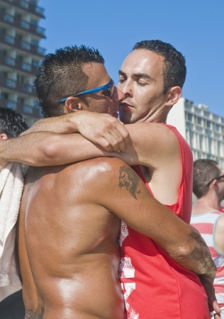 TEL AVIV , ISRAEL - JUNE 08  : An unidentified Israeli men huging during a beach party at Gordon beach followed the annual Gay pride in Tel Aviv on June 08 2012