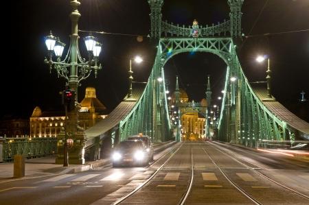 danuba: The Freedom bridge in Budapest Hungary by night Stock Photo