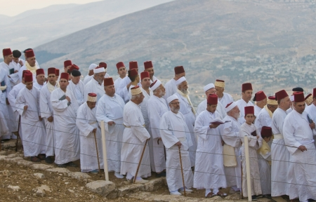 shavuot: NABLUS, WEST BANK - JUNE 24 : Members of the ancient Samaritan community during the holy day of Shavuot in Mount Gerizim on June 24 2012, Shavuot is an holyday commemoretas the anniversary of the day god have given the Torah to the Israelites