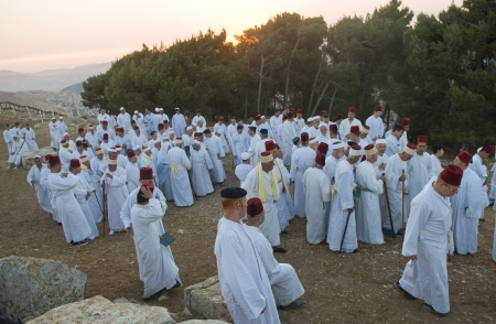 NABLUS, WEST BANK - JUNE 24 : Members of the ancient Samaritan community during the holy day of Shavuot in Mount Gerizim on June 24 2012, Shavuot is an holyday commemoretas the anniversary of the day god have given the Torah to the Israelites Stock Photo - 14174641