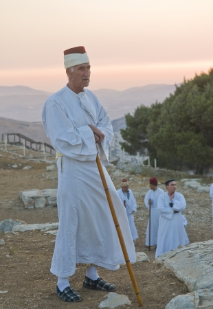 nablus: NABLUS, WEST BANK - JUNE 24 : Member of the ancient Samaritan community during the holy day of Shavuot in Mount Gerizim on June 24 2012, Shavuot is an holyday commemoretas the anniversary of the day god have given the Torah to the Israelites