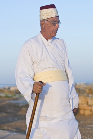NABLUS, WEST BANK - JUNE 24 : Member of the ancient Samaritan community during the holy day of Shavuot in Mount Gerizim on June 24 2012, Shavuot is an holyday commemoretas the anniversary of the day god have given the Torah to the Israelites