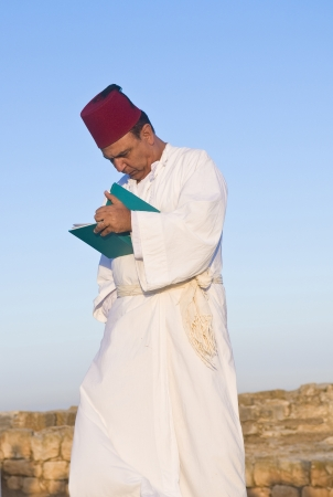 gerezim: NABLUS, WEST BANK - JUNE 24 : Member of the ancient Samaritan community during the holy day of Shavuot in Mount Gerizim on June 24 2012, Shavuot is an holyday commemoretas the anniversary of the day god have given the Torah to the Israelites