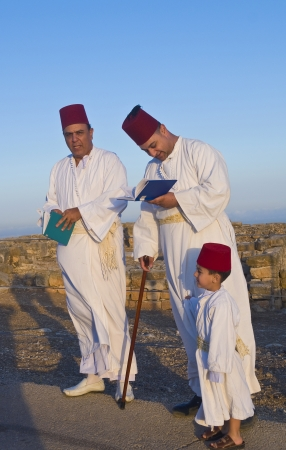 NABLUS, WEST BANK - JUNE 24 : Members of the ancient Samaritan community during the holy day of Shavuot in Mount Gerizim on June 24 2012, Shavuot is an holyday commemoretas the anniversary of the day god have given the Torah to the Israelites