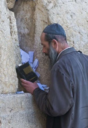 kotel: JERUSALEM - FEB 05 : Orthodox jewish man prays in The western wall on February 05 2011 , The Western wall is important Jewish religious site located in the Old City of Jerusalem , Israel Editorial