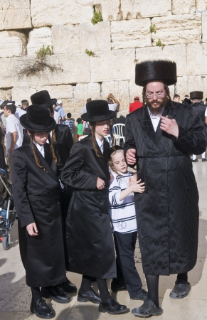 JERUSALEM - APRIL 08 : Orthodox jewish men prays in The western wall during Passover on April 08 2012 , The Western wall is important Jewish religious site located in the Old City of Jerusalem  Stock Photo - 14340357