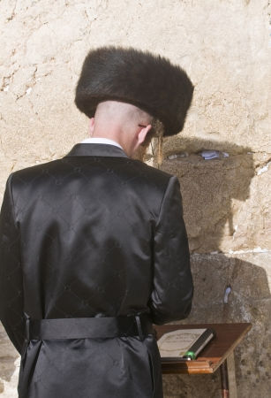 JERUSALEM - APRIL 08 : Orthodox jewish man prays in The western wall during Passover on April 08 2012 , The Western wall is important Jewish religious site located in the Old City of Jerusalem  Stock Photo - 14340352