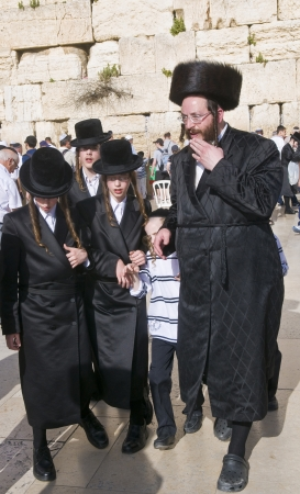 JERUSALEM - APRIL 08 : Orthodox jewish family in The western wall during Passover on April 08 2012 ,The Western wall is important Jewish religious site located in the Old City of Jerusalem