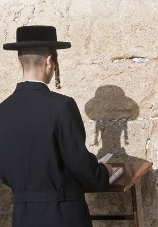 JERUSALEM - APRIL 08 : Orthodox jewish men prays in The western wall during Passover on April 08 2012 , The Western wall is important Jewish religious site located in the Old City of Jerusalem  Stock Photo - 14418265