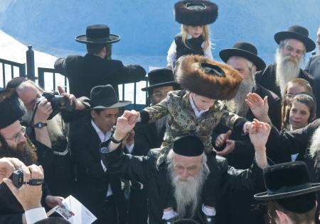 lag: MERON , ISRAEL - MAY 10 : Orthodox Jews celebrates Halake in Bar Yochai tomb in Meron , Israel on May 10 2012 , Halake is first haircut ceremony celebrated in Lag Baomer