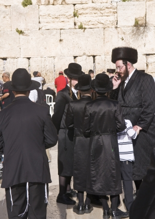 JERUSALEM - APRIL 08 : Orthodox jewish men prays in The western wall during Passover on April 08 2012 , The Western wall is important Jewish religious site located in the Old City of Jerusalem  Stock Photo - 14419706
