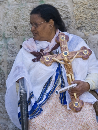 spirtual: JERUSALEM - APRIL 13 : Ethiopian Christian pilgrim carry across along the Via Dolorosa in Jerusalem on April 13 2012 commemorating the path Jesus carried his cross on the day of his crucifixion