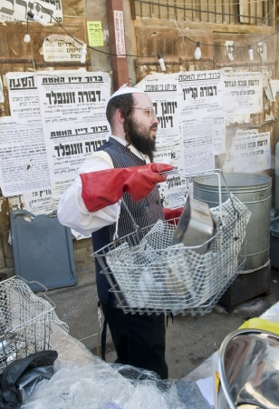 JERUSALEM - APRIL 05 : An Ultra Orthodox man is preparing to the Jewish holiday of Passover by purifacation of the dishes in Jerusalem Israel on April 05 2012 Stock Photo - 14582134
