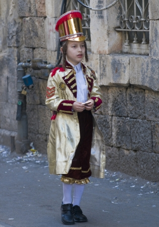 ultraorthodox: JERUSALEM - MARS 09 : Ultra Orthodox costumed boy during Purim in Mea Shearim Jerusalem on Mars 09 2012 , Purim is a Jewish holiday celebrates the salvation of the jews from jenocide in ancient Persia