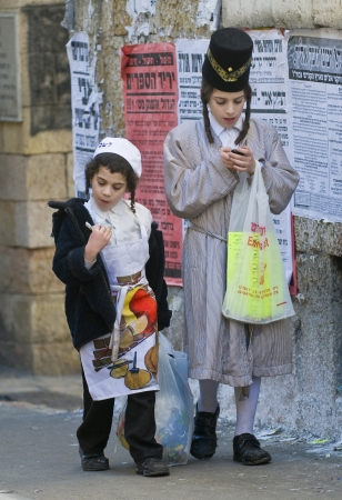 hasidim: JERUSALEM - MARS 09 : Ultra Orthodox costumed boys during Purim in Mea Shearim Jerusalem on Mars 09 2012 , Purim is a Jewish holiday celebrates the salvation of the jews from jenocide in ancient Persia