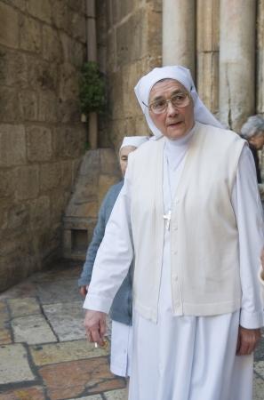spirtual: JERUSALEM - APRIL 08 : An unidentified nun visit the church of the Holy Sepulcher in Jerusalem Israel during Easter on April 08 2012